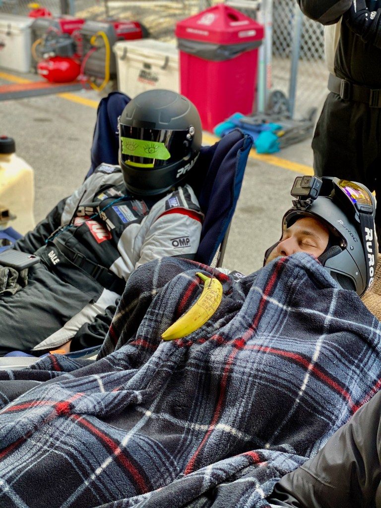 Pfaff Motorsport team members asleep during the morning hours of the Rolex 24 at Daytona